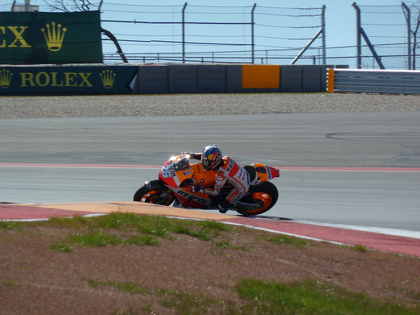 Pedrosa tips into Turn 1. Nobody is happy with grip at the track yet, least of all Dani
