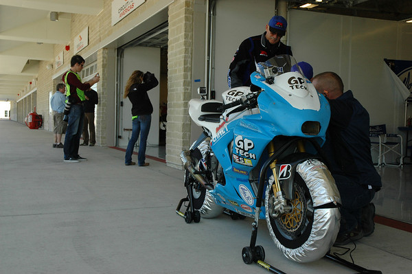 Only one wall separates the GP Tech team from the Yamaha garage. Might as well be a chasm.