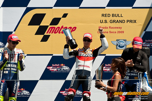 Dani Pedrosa, Valentino Rossi and Jorge Lorenzo on the podium at the 2009 Laguna Seca race